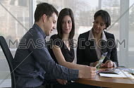 Real estate agent meets with clients