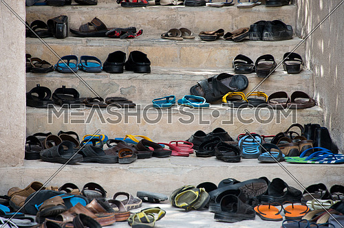 shoes infront of a mosque