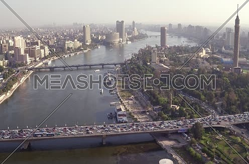 Aerial Shot for the River Nile to 6th of Octobre Bridge this Kasr Al Nile Bridge in background  at Cairo at Day
