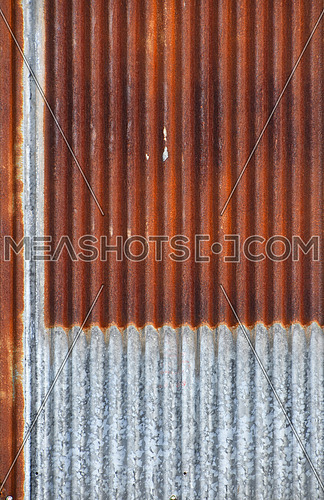 Old vintage bright rusty stained corroded metal goffered surface