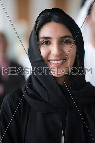 a woman wearing tradition arabian abaya smiling