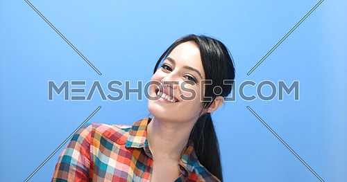 Beautiful face of young adult woman with clean fresh skin - studio portrait