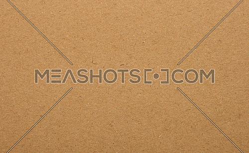 Close up natural brown paper parchment background texture with dark nap fibers pattern for design craft