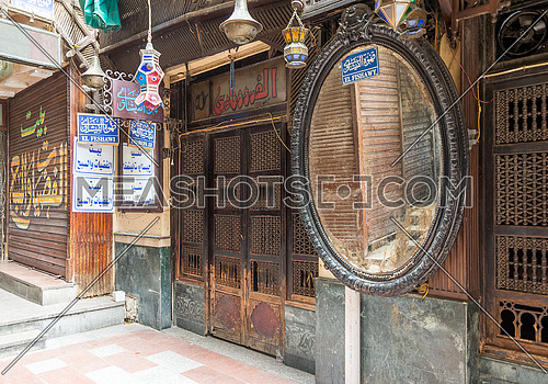 Cairo, Egypt- June 26 2020: Old famous coffeehouse, El Fishawi, located in historic Mamluk era Khan al-Khalili famous bazaar and souq, closed during Covid-19 lockdown for the first time since 1773