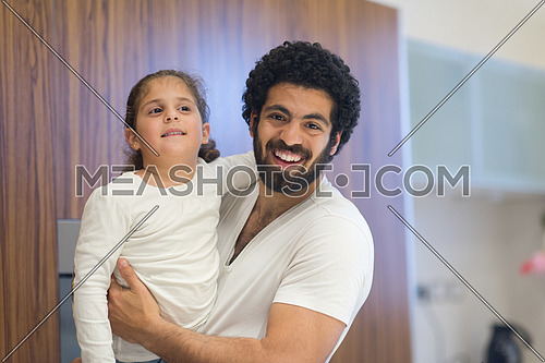 Young middle east father and daughter happily spend time in the kitchen