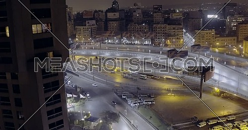 Drone Get Down for 6 of October Bridge over Abd Elmonan Reyad Bus Station At Tahrir Area in cairo at night