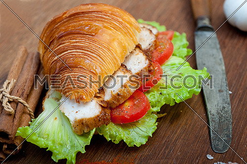 savory croissant brioche bread with chicken breast and vegetable rustic style