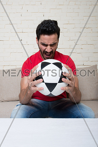 football fan watching a game with a ball