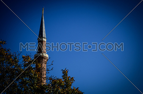 A mosque tower in an Othmany (old Turkish) style mosque that looks like a sharp pencil.