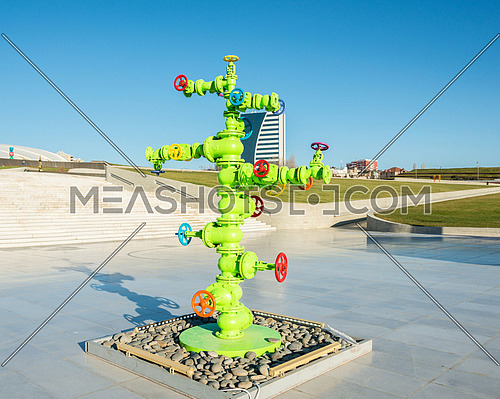 Modern art installation with oil industry piping