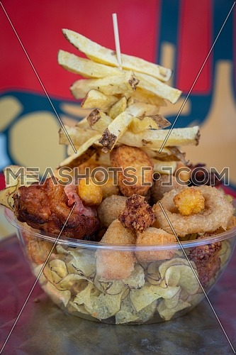Mix fried fish and meat in set box, cooked sea fish in organic plastic container, concept cooked in set box for delivery.