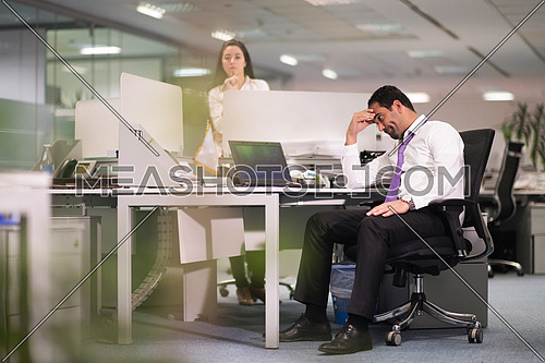 frustrated young business man working on desktop  computer at modern office