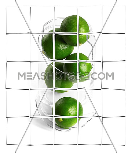 shattered glass jar with lime on white background