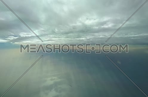 POV shot from plane front flying through clouds