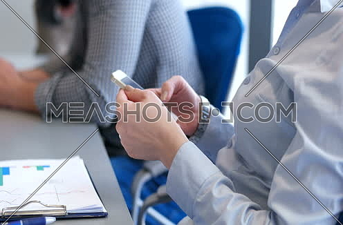 close up of hands using smartphone during conference