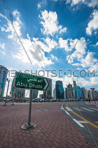 The way to Abu Dhabi sign