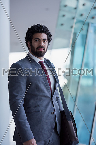 handsome middle eastern business man portrait with laptop bag  at airport terminal