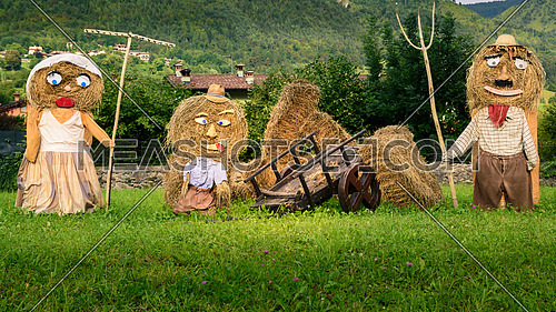 Family straw dolls outdoor italy