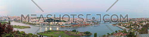 Istanbul city view from Pierre Loti Teleferik station overlooking Golden Horn with Halic Bridge, Golden Horn Metro Bridge and historical mosques at dusk time, Eyup District, Istanbul, Turkey