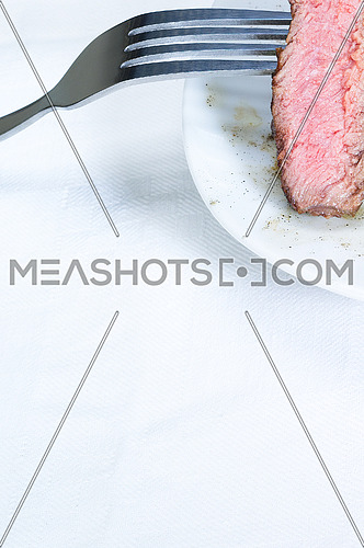 fresh juicy beef ribeye steak slice grilled with fork over a plate