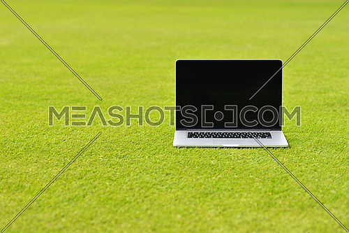 laptop comuter on grass, freedom communication concetp and education and study