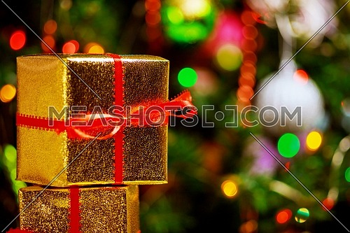 Christmas tree with gifts, beautiful christmas gift boxes concept, and festive bokeh lighting