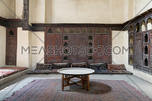 Room at El Sehemy house, an old Ottoman era house in Cairo, built in 1648. with built-in couch, and embedded wooden cupboard, Cairo, Egypt
