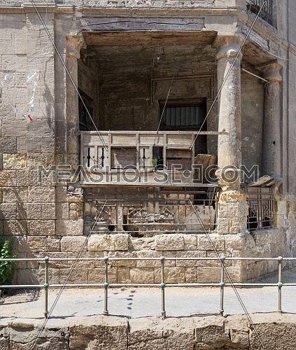 Facade of abandoned ruined grunge balcony, Darb El Labana district, Cairo, Egypt