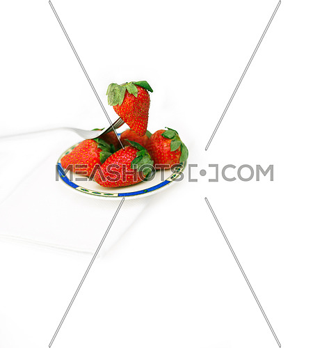 fresh strawberries on little dish isolated over white