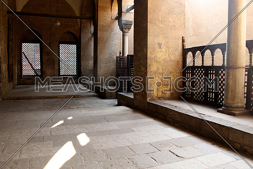 a photo from inside a historical mosque in Islamic Cairo, Egypt showing  architecture  style used at that time