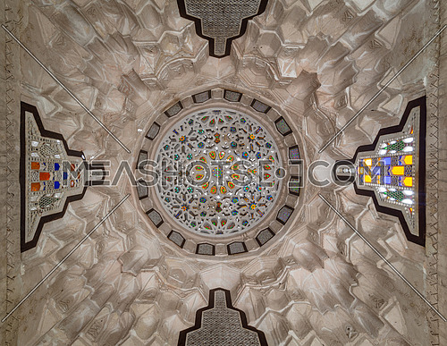Carved plaster dome decorated with colored glass pieces of a pergola in front of El sehemy historical house, El Moez street, Cairo, Egypt