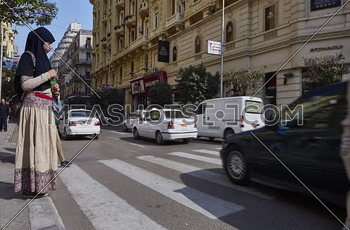 Fixed shot for pedestrain crossing Sherif Basha Street at cairo at Day