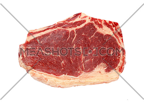 Close up one raw ribeye beef steak with rib bone isolated on white background, elevated top view, directly above