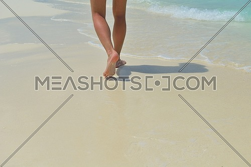 footsteps on beautiful white sand beach at summer vacation