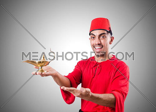 Turkish man with lamp on white