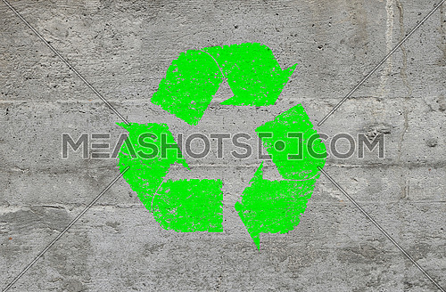 Grunge Concrete Background With Green Recycling Logo Sign