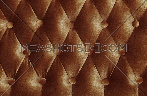 Dark brown capitone textile background with buttons, retro Chesterfield style soft tufted fabric furniture upholstery diamond pattern decoration, close up