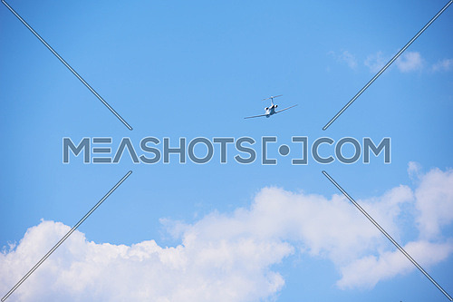 small retro airplane, clear blue sky in background