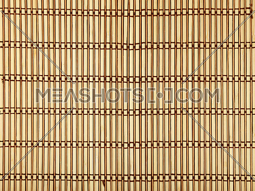 Beige and brown natural wooden braided bamboo mat background texture with vertical planks and dark horizontal thread, close up