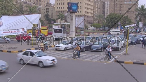 Fly Over top shot for Traffic in Moustafa Mahmoud Square in 22th of March 2018 in Giza  at day.