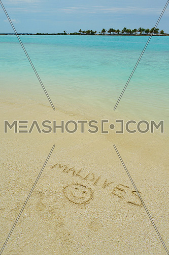 tropical beach nature landscape scene with white sand at summer with the word maldives written on the sand