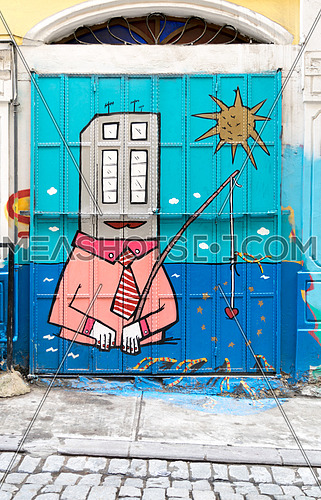Closed shop exterior with roller door covered with colorful graffiti near Istiklal Street, Istanbul, Turkey