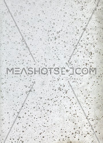 Background texture of solid transparent white glass with pattern of air bubbles, close up