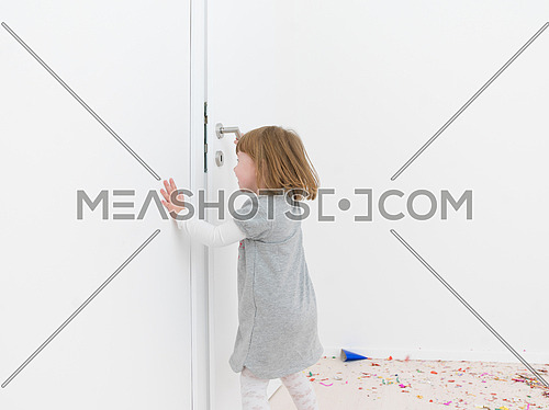 adorable Little girl standing on confetti after party