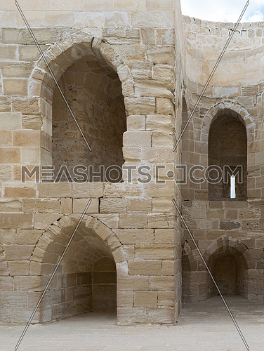 Ruins of olld wall with arched cavities at the citadel of Alexandria, Egypt