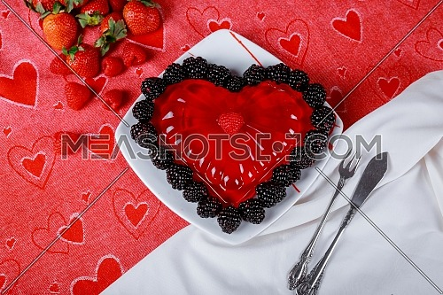 Nice jelly in the form in the form of heart on the table, a white plate