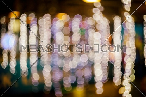 Defocused of blurred bokeh background with warm colorful lights