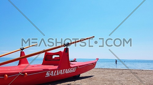 Mediterranean beach with reascue boat moscone