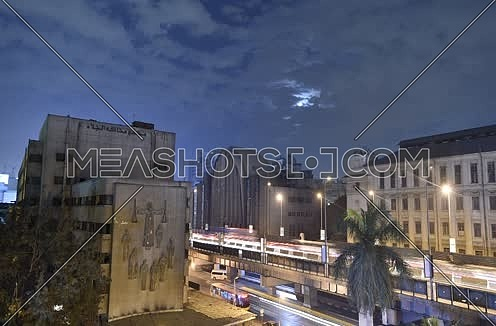 Cairo by night time lapse showing 6 october bridge and al jalaa court