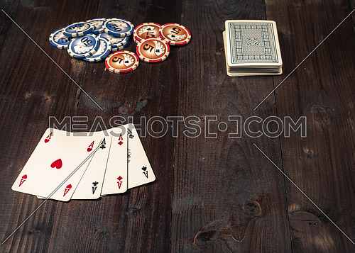 vintage american poker on background wooden